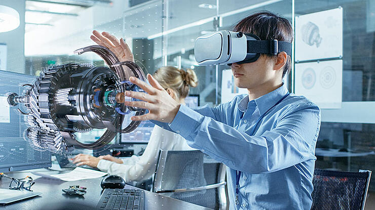 Engineer-wearing-Virtual-Reality-Headset-Works-with-3D-Model-Hologram-Visualization