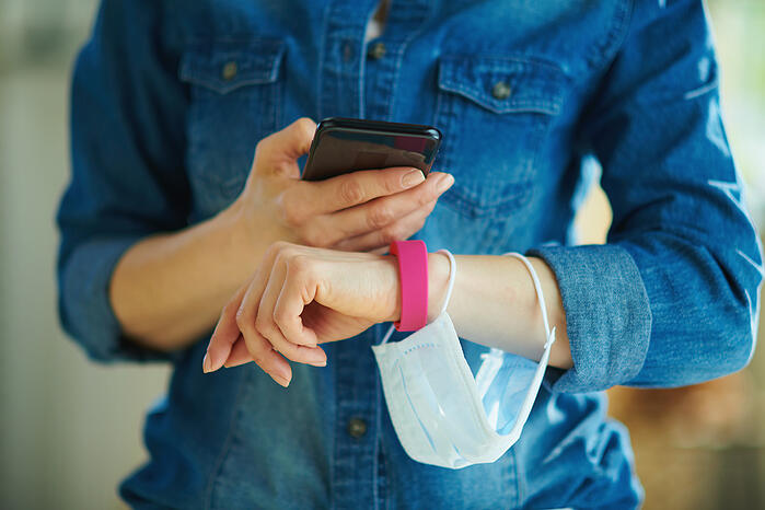 a-smartphone-and-fitness-tracker-checking-stats-the-house