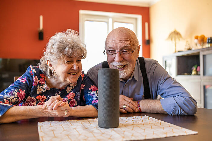 excited-senior-couple-using-a-Virtual-Assistant-at-home