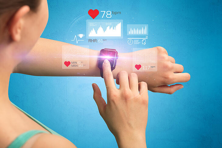 female-hand-with-smartwatch-and-health-application
