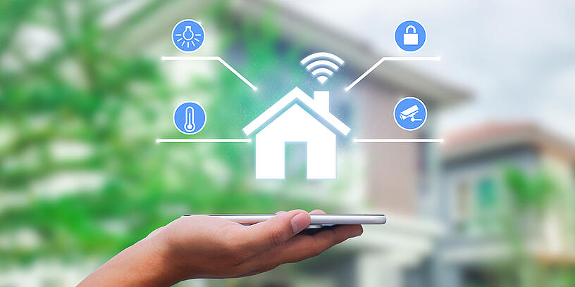 hands-holding-smartphone-with-app-smart-home-twitter