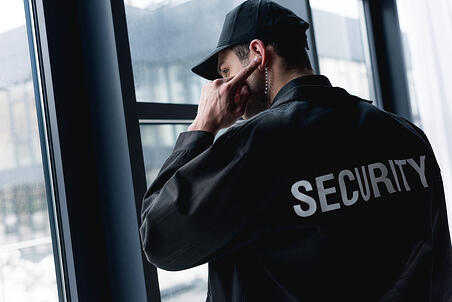 security-guard-wearing-jacket-and-hat-listening